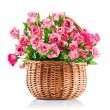 Bunch pink roses in wicker basket — Stock Photo #47215595