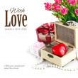 Red heart wooden casket with bunch roses — Stock Photo