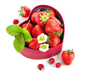 Fresh strawberries in box as heart with green leaf — Stock Photo