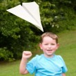 Child playing with paper airplane — Stok fotoğraf