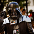 Постер, плакат: ATLANTA Sept 1: A Star Wars fan dressed as Darth Vader marches in the annual DragonCon parade on Sept 1 2012 DragonCon bills itself as the largest Sci Fi convention in the world