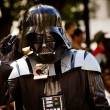 ATLANTA - Sept. 1: A Star Wars fan dressed as Darth Vader marches in the annual DragonCon parade on Sept. 1, 2012. DragonCon bills itself as the largest Sci-Fi convention in the world. — Stock Photo