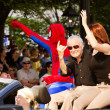 Stock Photo: Spider-Mcreator StLee waves to crowd at annual DragonCon parade