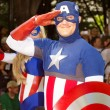 A comic book fan dressed as Captain America salutes at the annual DragonCon parade — Stock Photo