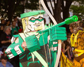 A comic book fan dressed as Green Arrow marches in the annual DragonCon parade — Stock Photo