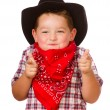 Child dressed up as cowboy playing isolated on white — Stockfoto