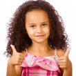 Portrait of pretty African-American mixed race child giving thumbs up against white background — Stock Photo