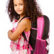 Mixed race African American girl wearing backpack for school against white background - Foto Stock