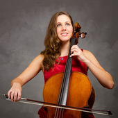 Young woman cello player — Stock Photo