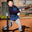 Boy batting during t-ball practice — Stock Photo #20613735