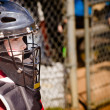 Child playing catcher during baseball game with space for copy — Stock Photo
