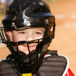 Portrait of child with catcher's equipment on during baseball game — Stock Photo