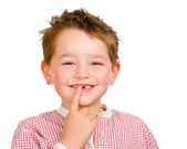 Child showing off his lost teeth isolated on white — Stockfoto