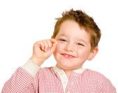 Child showing off his lost tooth isolated on white — Stock Photo
