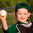 Young child in catcher s gear throwing baseball — Stock Photo