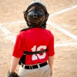 Child playing catcher during organized league baseball game — Stock Photo