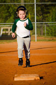 Young child running bases while playing baseball — Stock Photo