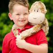 Portrait of boy playing with his stuffed animal pet — Stok fotoğraf