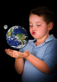 Fascinated and curious child studying the Earth between his hands in education or environment concept, with elements of this image furnished by NASA — Stock Photo