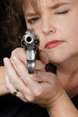 Close up of gun being held by woman — Stock Photo