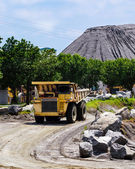 Dump truck carrying a load at a rock quarry — Stock Photo