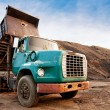 Old dump truck at excavation site — Stock Photo