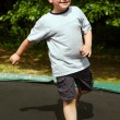 Child playing on trampoline — Stock Photo #26155651
