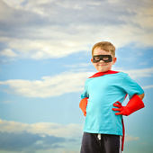 Child pretending to be a superhero with copy space — Stock Photo