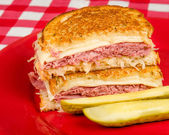 Corned Beef Reuben Sandwich - Fresh corned beef on grilled Rye with melted Swiss and sauerkraut. — Stock Photo