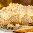 Baked bratwurst with sauerkraut on rye bread — Stock Photo