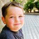 Portrait of child at city park — Stock Photo #28539889