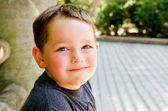 Portrait of child at city park — Stock Photo