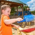 Child playing in sandbox at playground — Stock Photo #28690397