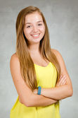 Studio portrait of happy pretty, teen girl smiling — Stock Photo