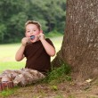 Child eating ice cream treat outdoors on hot summer day — Stock Photo #29006635