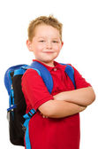 Back to school education concept with portrait of happy grade school student wearing backpack — Stock Photo