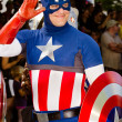 Stock Photo: Comic book fdressed as Captain Americin parade