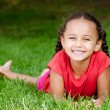 Summer portrait of pretty mixed race girl outdoors in natural setting — Stock Photo