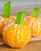 Halloween child friendly treats with clementines made to look like pumpkins — Zdjęcie stockowe