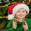 Christmas portrait of happy child wearing Santa hat  — Stock Photo