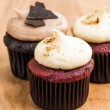 Trio of chocolate and red velvet mini cupcakes with cream cheese frosting — Stock Photo #37947039