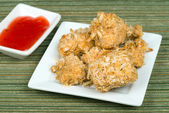 Baked coconut chicken with sweet and sour dipping sauce — Stock Photo