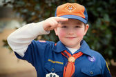 Cub Scout giving Boy Scout salute — Stock Photo