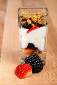Mini mixed berry yogurt parfait in dessert shot glass or trifle with strawberries and blackberries — Stock Photo