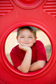 Portrait of young child playing on playground  — Stock Photo