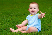 Summer portrait of happy baby boy infant outdoors at park — Stock Photo