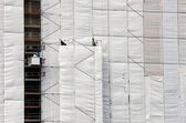 Tarpaulin on a building — Stockfoto