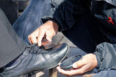 The shoe shiner — Stock Photo