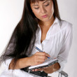 Young woman writing in notebook — Stock Photo