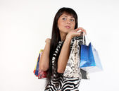 Beautiful girl with her shopping bags — Stock Photo